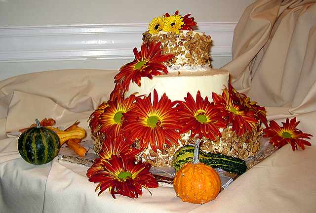 Wedding cake decorated w/real flowers.