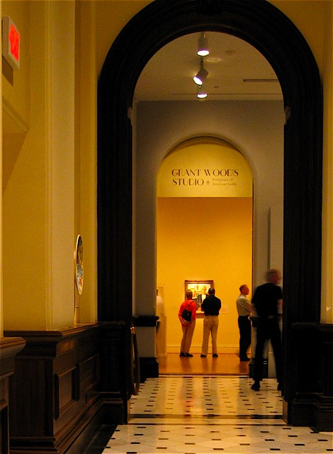 Looking down the hall at the famous Grant Woods painting.