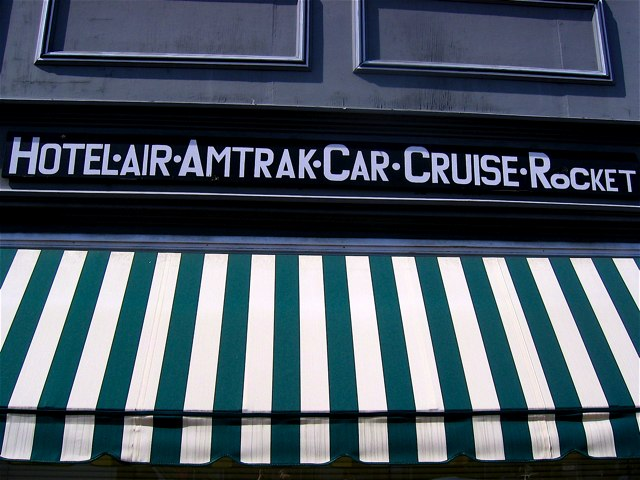 A travel agency sign on U St. NW.