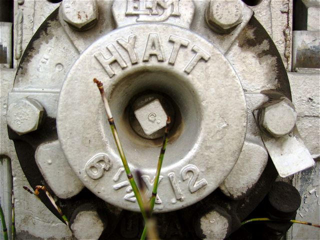 The hub of one of the wheels on the train engine