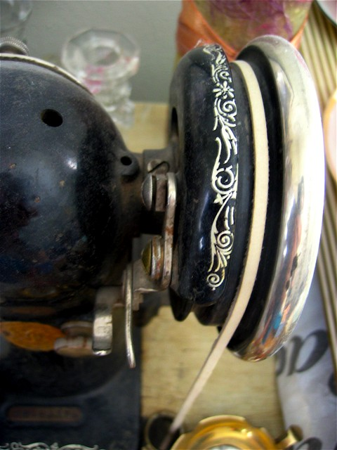 The handwheel on my sister's antique sewing machine.